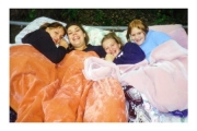 Karly, Jenna, Jess and Kelly sleeping on Tramp in back yard
