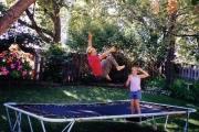 Krista and Jess on backyard trampoline (2001)