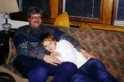 Nikki cuddling with Dad on Christmas (2000)